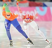 Subject: Lotte van Beek, Olga Fatkulina; Tags: Athlet, Athlete, Sportler, Wettkämpfer, Sportsman, Damen, Ladies, Frau, Mesdames, Female, Women, Eisschnelllauf, Speed skating, Schaatsen, Lotte van Beek, NED, Netherlands, Niederlande, Holland, Dutch, Olga Fatkulina, RUS, Russian Federation, Russische Föderation, Russia, Sport; PhotoID: 2013-12-08-0476